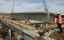 38 tonne beam lowered into position for new bridge over main trunk rail line at Manukau