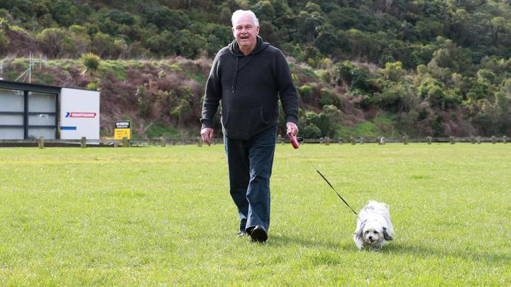 Picton man Fredrick Wilson walks his dog Milly at Picton's Memorial Park, which he fears residents will be unable to do if it's made a freedom camping site.