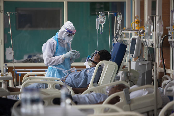 A medical staff member looks after a Covid-19 patient at the Intensive Care Unit of the Sharda Hospital, in Greater Noida in July 2020.