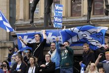 Pro-Independence supporters demonstrate in Glasgow on the eve of Scotland's independence referendum.