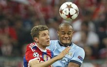 Thomas Mueller of Bayer n Munich and Vincent Kompany of Manchester City.