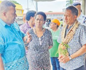 United Nations Pacific co-ordinator Sanaka Samarasinha (right) meets  members of the Market Vendors Association in western Viti Levu in Fiji.