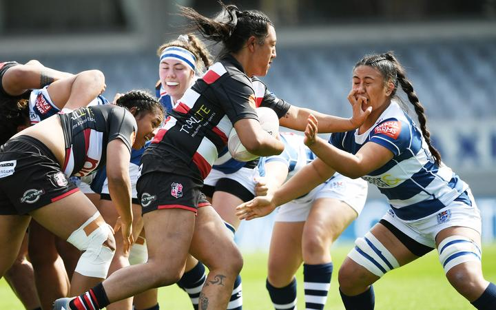 Harono Te Iringa fends off Liana Mikaele-Tu'u in the Farah Palmer Cup match between Auckland Storm and Counties Manukau at Eden Park, Auckland, New Zealand.  Sunday 20 September 2020.