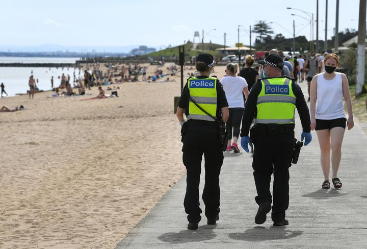 Police enforcing Covid-19 restrictions patrol Elwood Beach in Melbourne in the weekend.
