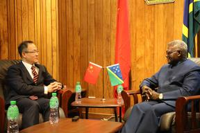 Solomon Islands prime minister Manasseh Sogavare (left) with Li Ming, China's first ambassador to Solomon Islands.