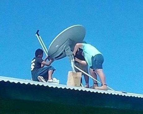 A satellite dish is installed as part of the WIFI project