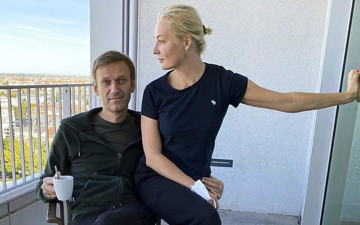 This handout picture posted on September 21, 2020 on the Instagram account of @navalny shows Russian opposition leader Alexei Navalny and his wife Yulia Navalnaya in Berlin's Charite hospital.