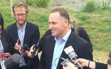 John Key talks to the media on the penultimate day of the election campaign.