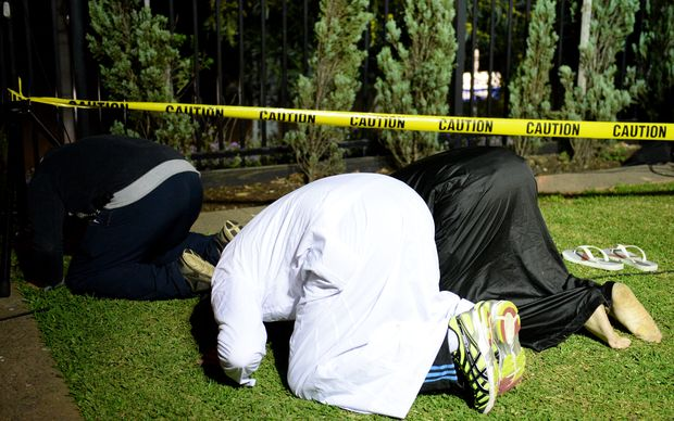 Members of the Sydney Muslim community pray prior to a rally against counter-terrorism raids across western Sydney of people with suspected links to the terror group Islamic State.