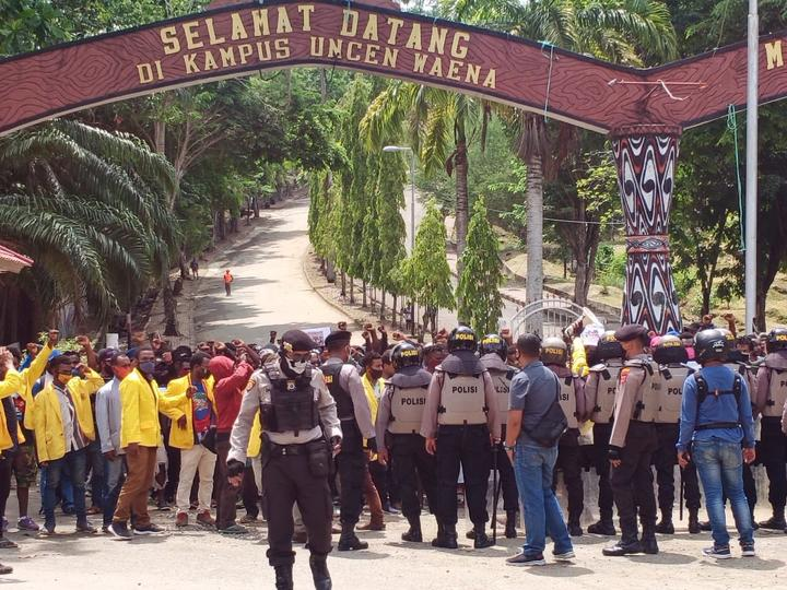 Indonesian police stop a protest by West Papuan students at Cenderawasih University in Jayapura, 28 September 2020.