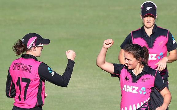 New Zealand's Amy Satterthwaite and Amelia Kerr celebrate after Kerr takes a wicket.