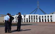 Australian Federal Police officers are seen outside Parliament House in Canberra, after 'chatter' about a possible terrorist attack
