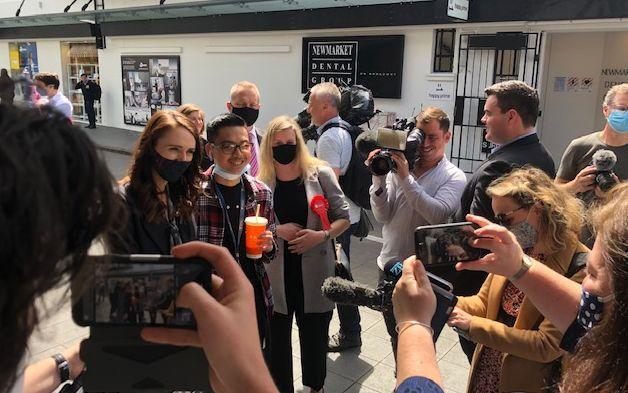 Labour leader Jacinda Ardern takes a photo with a member of the public in Newmarket, Auckland during the 2020 campaign trail.