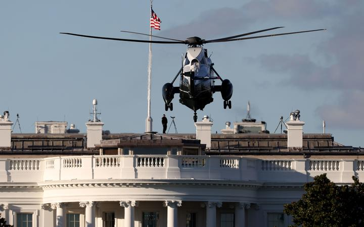 WASHINGTON, DC - OCTOBER 02: Marine One, the presidential helicopter, arrives at the White House to carry U.S. President Donald Trump to Walter Reed National Military Medical Center October 2, 2020 in Washington, DC.