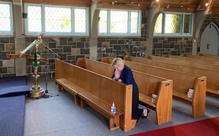 National party leader Judith Collins prays at St Thomas Church in Tāmaki before casting her early vote for the election.
