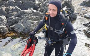 Green co-leader James Shaw goes scuba diving at Taputeranga marine reserve in Island Bay, Wellington, hoping to promote the party's marine policy.