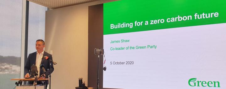 Green Party co-leader announces sustainable building policy.