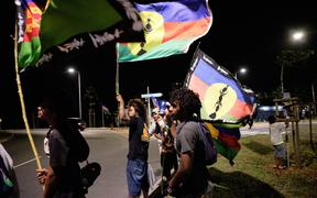Kanak independence supporters wave flags of the Socialist Kanak National Liberation Front (FLNKS) after the referendum on independence on the French South Pacific territory of New Caledonia in Noumea on October 4, 2020. (Photo by Theo Rouby / AFP)