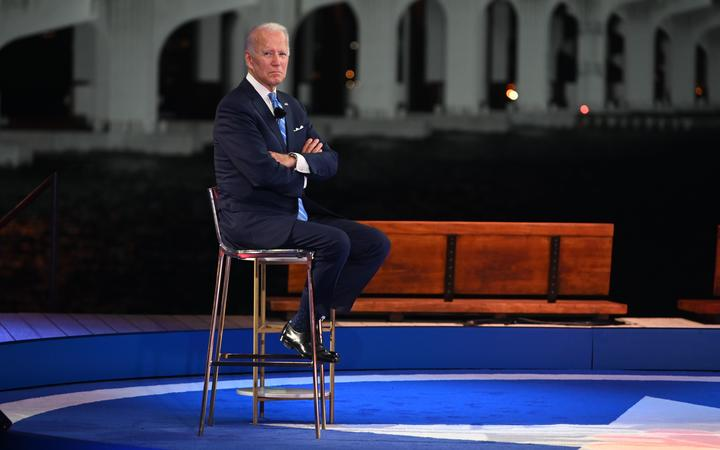 Democratic presidential nominee and former Vice President Joe Biden participates in an NBC Town Hall event at the Perez Art Museum, with the MacArthur Causeway in the background, in Miami, Florida on October 5, 2020.