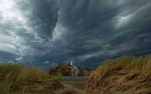 Dark clouds gather during a previous storm over Castlepoint, Wairarapa.