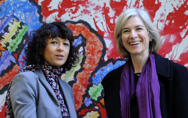 French researcher in Microbiology, Genetics and Biochemistry Emmanuelle Charpentier (L) and US professor of Chemistry Jennifer Doudna posing beside a painting made by children of the genoma at the San Francisco park
