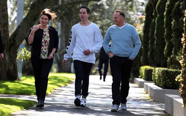 John key with his wife Bronagh and son Max walking to Parnell school to vote