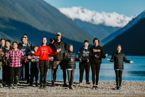 Young people take part in a Ngāti Apa iwi Rangatahi programme on the shores of Lake Rotoiti at a winter wānanga.