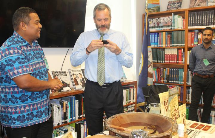US Ambassador Joseph Cella indulges in the traditional Fijian brew as Fiji kava industry officials George Kotobalavu, left, and Shaneel Nair look on.
