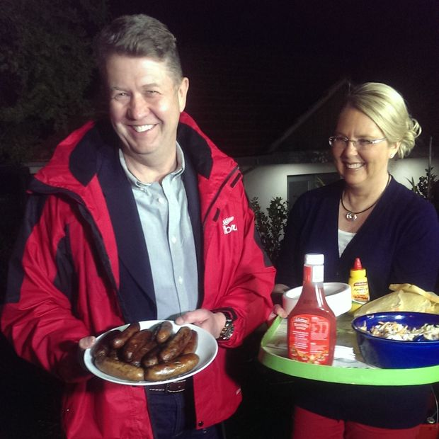 David Cunliffe and and wife Karen Price distribute food to reporters outside their Herne Bay home.