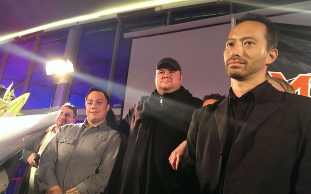 "Kim Dotcom (centre) said his brand was ""poison for what we were trying to achieve."""