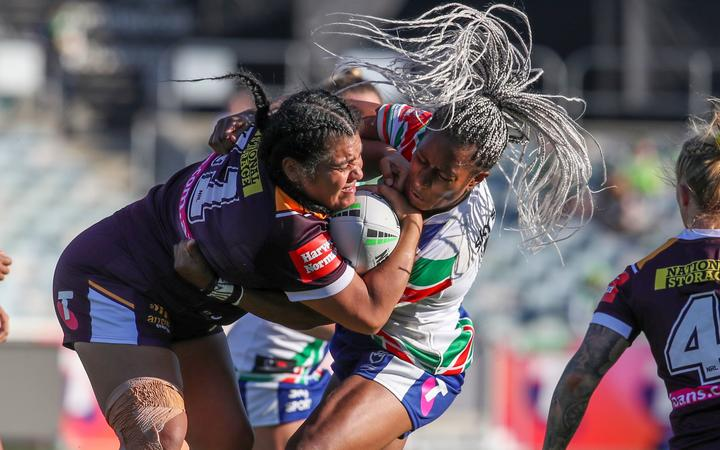 Ellia Green tackles Amber Hall. Warriors v Broncos, NRLW Telstra Women's Premiership.