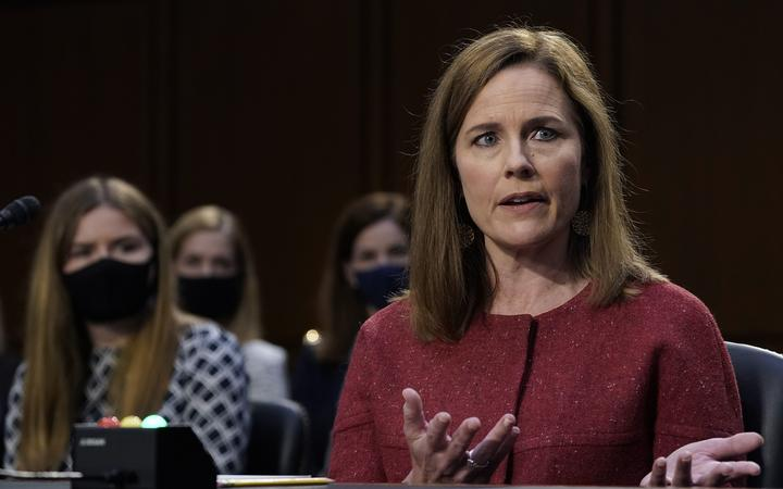 Supreme Court nominee Judge Amy Coney Barrett participates, with her family behind her, in the second day of her Senate Judiciary committee confirmation hearing on Capitol Hill on October 13, 2020 in Washington, DC.