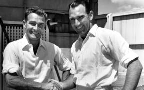 New Zealand cricket players Bert Sutcliffe (l) and John Reid (r) shake hands at the Plunket Shield Cricket competition, 1959.