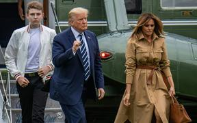 Barron Trump, left, with US President Donald Trump and Melania Trump pictured in August.