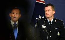 Australia's Prime Minister Tony Abbott (L) holds a news conference with Federal Police Commissioner Andrew Colvin, during an anti-terror crackdown.