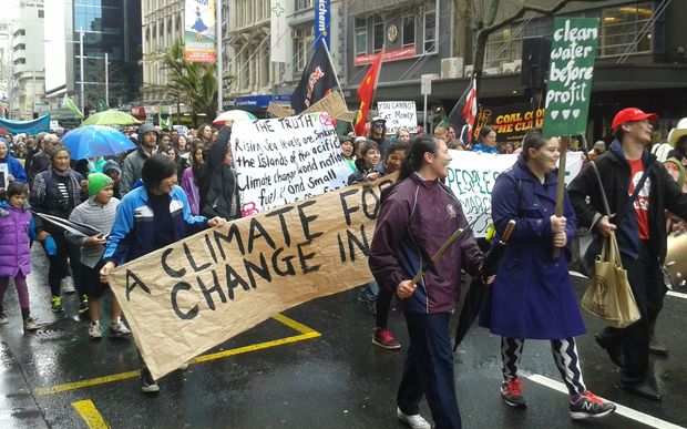 About 300 people marched up Auckland's Queen Street as part of a global protest urging more action on climate change.