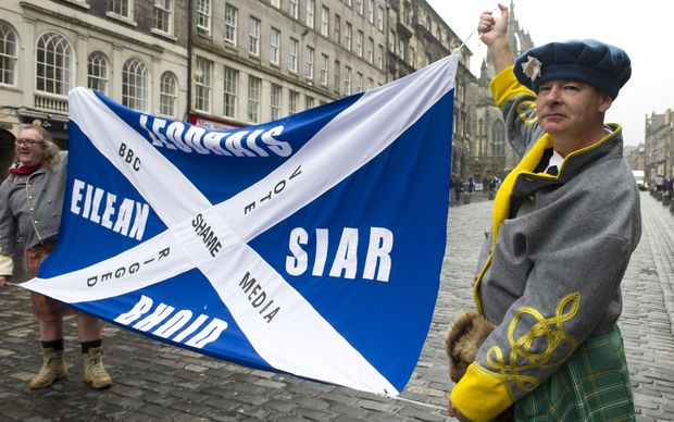 Pro-independence voters march down Edinburgh's Royal Mile to protest Scotland's referendum results.