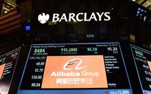 A screen with Alibaba's stock price on the floor at the New York Stock Exchange.