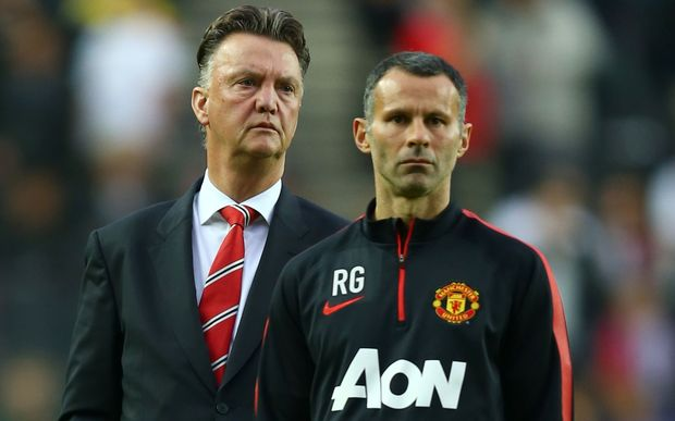 Louis van Gaal, Manager of Manchester United and assistant, Ryan Giggs. 2014.