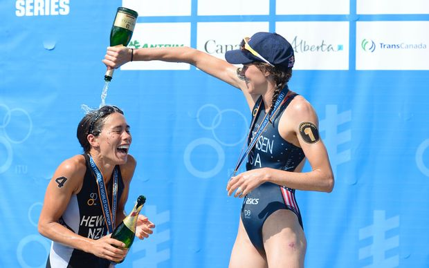 Andrea Hewitt NZL, Gwen Sorensen USA celebrate on the podium. 2014.