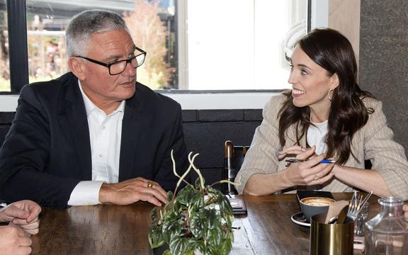 New Zealand Prime Minister Jacinda Ardern (R) speaks with MP Kelvin Davis and other senior members of parliament a day after her landslide election win, in Auckland on October 18, 2020.