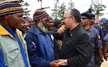 Papua New Guinea Prime Minister Peter O'Neill greets citizens in Southern Highlands.