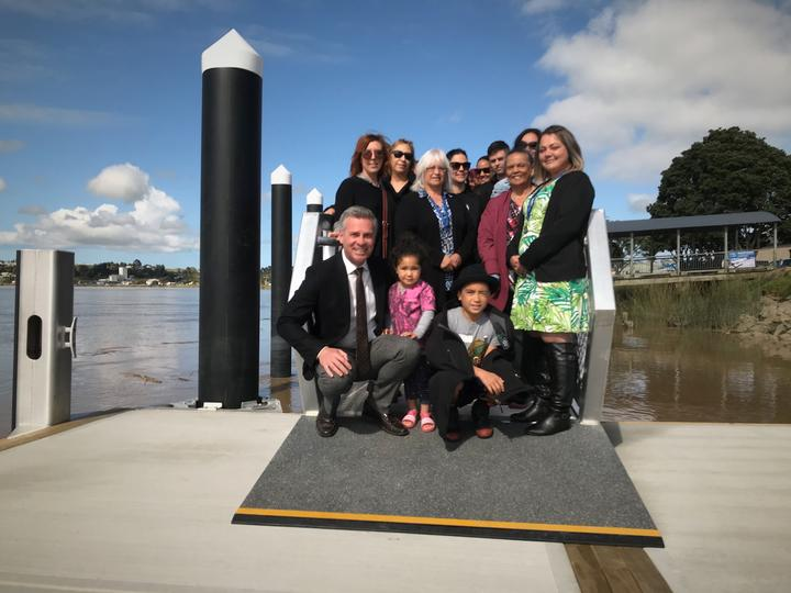 About 50 people gathered for a blessing of the new Dargaville pontoon. At front (from left) Kaipara Mayor Dr Jason Smith with youngsters Riria Hokai (in pink) Lawry Toko (black hat) and Natalie Dyer, KDC Kaipara Kickstart project coordinator.