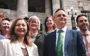 The Green Party getting a photo taken outside Parliament on the first day of the new term.