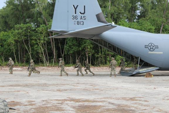 A US Air Force C-130 Hercules delivering US Army Pacific Soldiers onto Palau's Angaur Airfield.