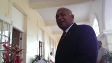 Frank Bainimarama arrives for his swearing in ceremony at Government House in Suva after his landslide victory at the 2014 election