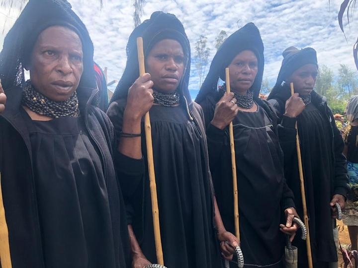 Highlands women attend a funeral for a victim of a sorcery accusation-related attack