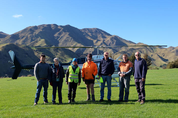 Checking out the Awatere area are, from left, trustee Stuart Dudley, councillor Barbara Faulls, trust co-ordinator Jaquetta Bradshaw, pest controller Andrew Withers, trust chair John Oswald, Marlborough Helicopter pilot Simon Moar, and trustee Ross Beech.