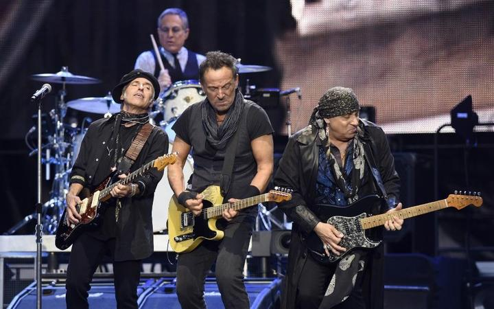 "(L-R) US musicians Nils lofgren, Bruce Springsteen and Stevie Van Zandt perform on stage during ""The river Tour 2016"" in the northern Spanish Basque city of San Sebastian on May 17, 2016. (Photo by ANDER GILLENEA / AFP)"