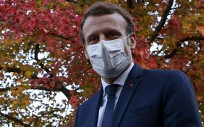 French President Emmanuel Macron looks on as he speaks to the press after chairing a meeting with the medical staff of the Rene Dubos hospital center, in Pontoise, in the Val d'Oise, on October 23, 2020,